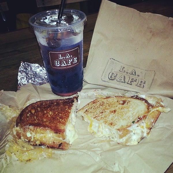 Photo taken at LA Café by Brady S. on 7/28/2013