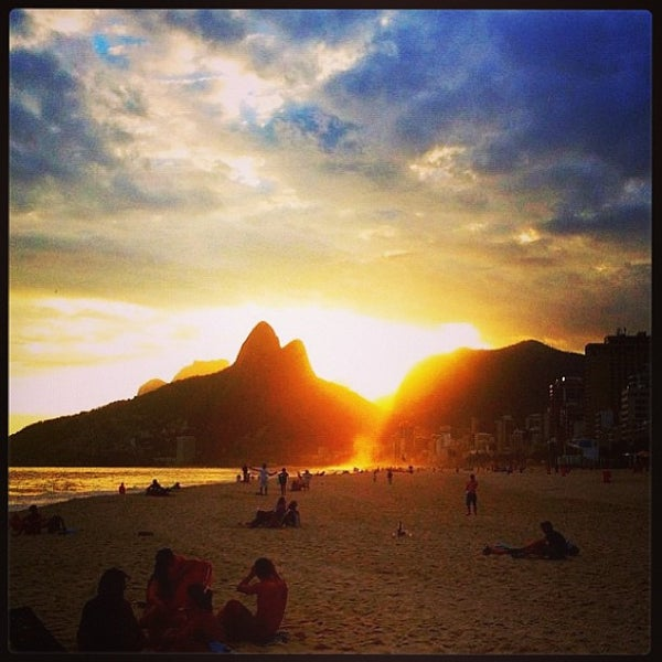 Photo taken at Praia de Ipanema by Bianca R. on 6/1/2013