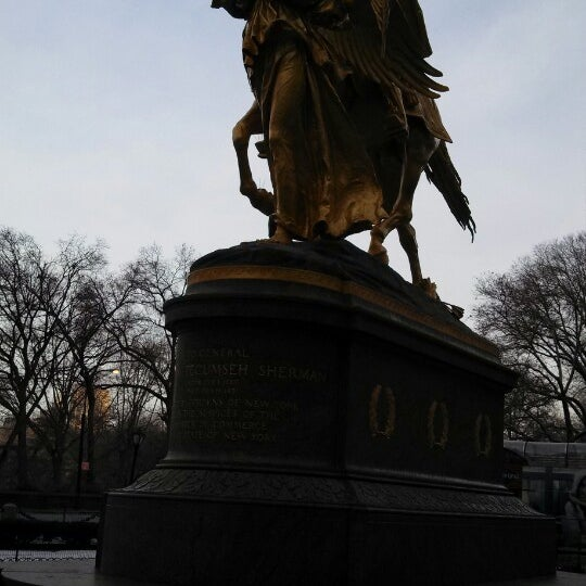 Photo taken at Grand Army Plaza by Mauricio P. on 12/21/2013