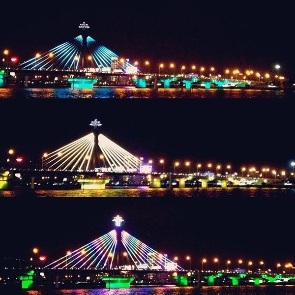 Photo taken at Cầu Sông Hàn (Han River Bridge) by AUManiac T. on 12/27/2012