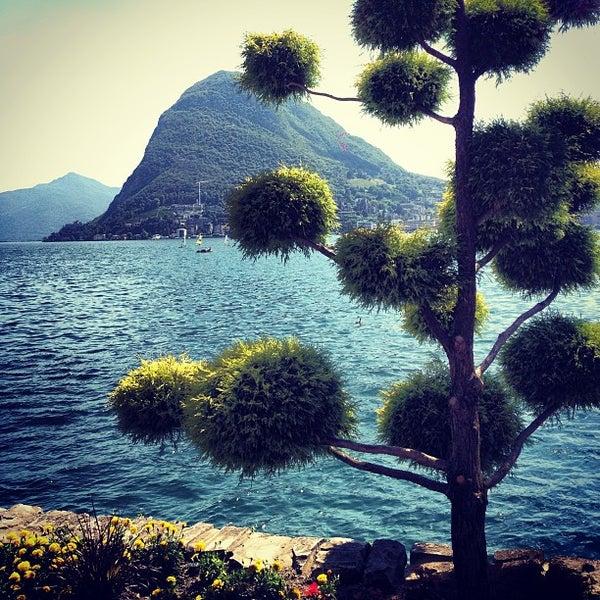 Photo taken at Lago di Lugano by Victor K. on 7/4/2013