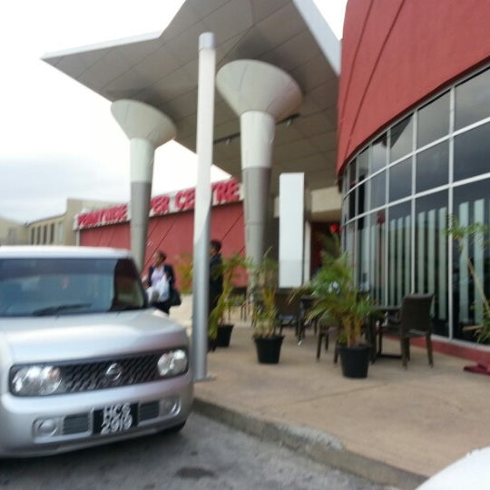 Photo taken at Trincity Mall by Dwight N. on 2/6/2013