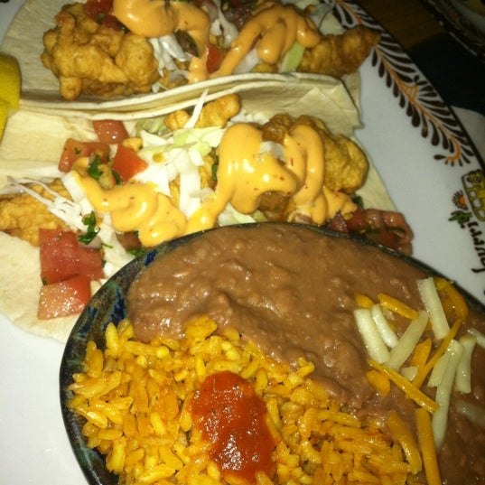 Photo taken at Burrito Bar & Kitchen by Shanon S. on 4/3/2012