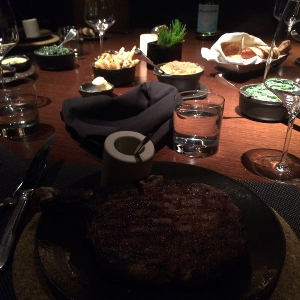 Photo taken at Jean Georges Steakhouse by Mauricio M. on 12/14/2014