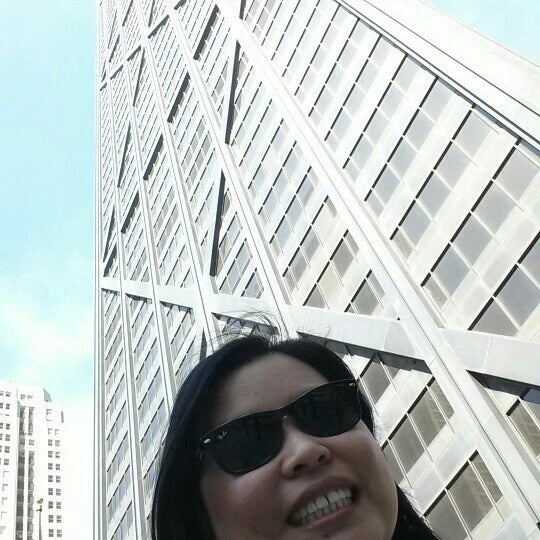 Photo taken at John Hancock Center by Mumu O. on 5/1/2015