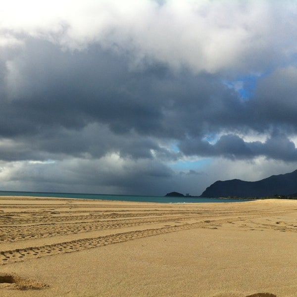 Photo taken at Maili Beach by Christine M. on 1/4/2013