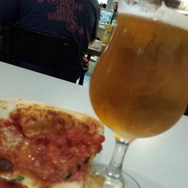Photo taken at Regents Pizzeria by Kris on 8/29/2013
