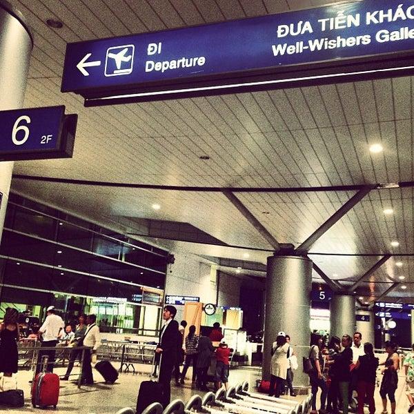 Photo taken at Tan Son Nhat International Airport (SGN) Sân Bay Quốc Tế Tân Sơn Nhất by Ken N. on 6/19/2013