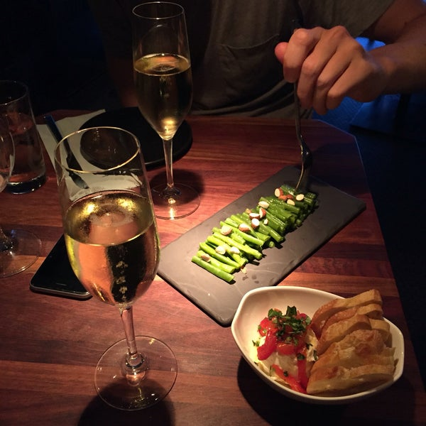 Get some indulgent (and cheesy) bar food to accompany your wine. We had the chèvre with spicy peppers and truffled haricots verts with champagne, yum!