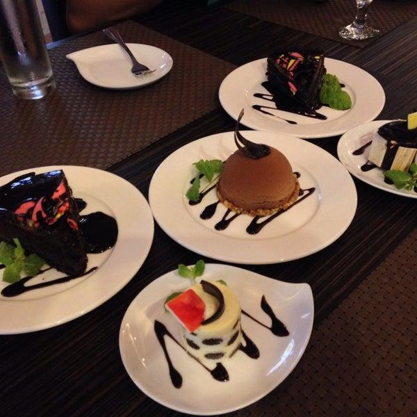 Photo taken at Sweet Bella Cafe by NicNic R. on 10/4/2013