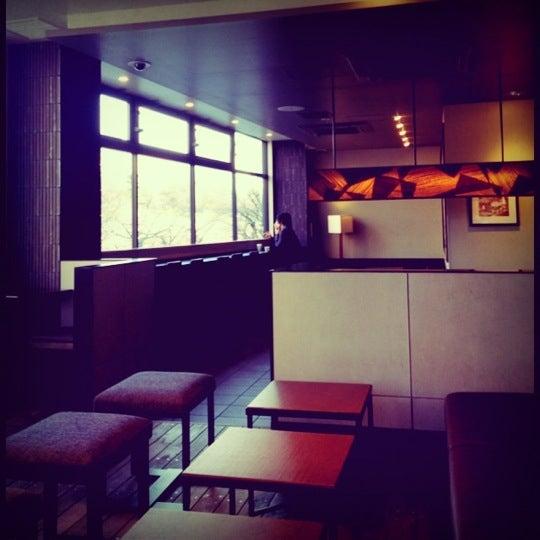 Photo taken at Starbucks Coffee 神楽坂下店 by Charlotte C. on 3/21/2012