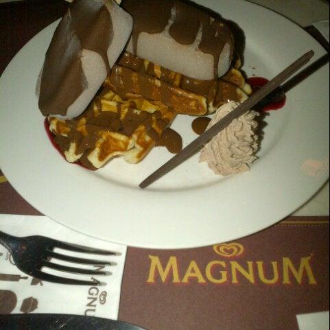 Photo taken at The New Magnum Café by Erlindah D. on 1/9/2013