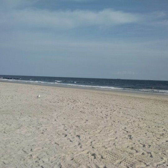 Photo taken at East Atlantic Beach by Adam S. on 8/16/2014