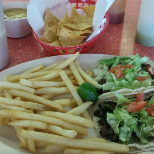 Photo taken at Taqueria el Chorrito by Kevin M. on 9/11/2015