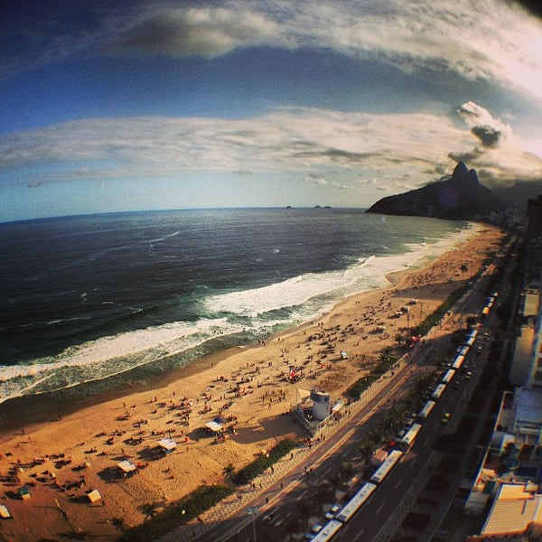 Photo taken at Praia de Ipanema by Guto M. on 7/28/2013