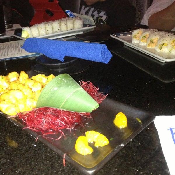 Photo taken at Blue Wasabi Sushi & Martini Bar by Eric J. on 2/11/2013