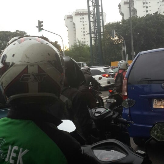 Photo taken at Perempatan Kuningan (Traffic Light) by Ira M. on 3/16/2015