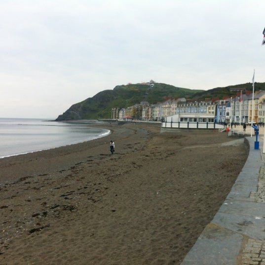 Photo taken at Aberystwyth Beach by Dan S. on 5/19/2012