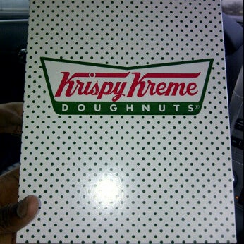 Photo taken at Krispy Kreme Doughnuts by Chris T. on 3/16/2012