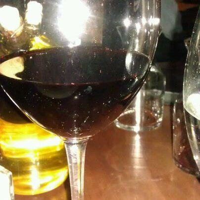 Photo taken at Lala's Wine Bar & Pizzeria by Valerie G. on 2/4/2012