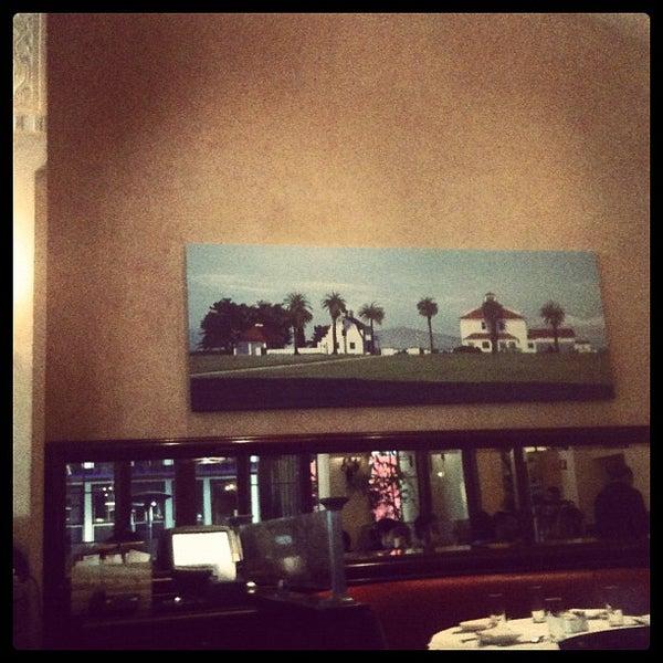 Photo taken at Village California Bistro & Wine Bar by Misha B. on 2/18/2012
