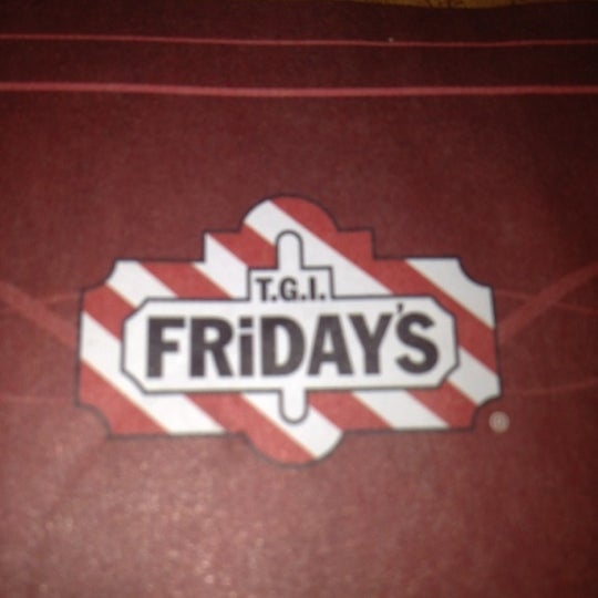 Photo taken at T.G.I. Friday's by Nidia C. on 2/18/2012