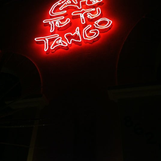 Photo taken at Café Tu Tu Tango by Megan M. on 6/2/2012