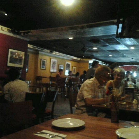 Photo taken at Joe Squared Pizza & Bar by Meagan N. on 7/6/2012