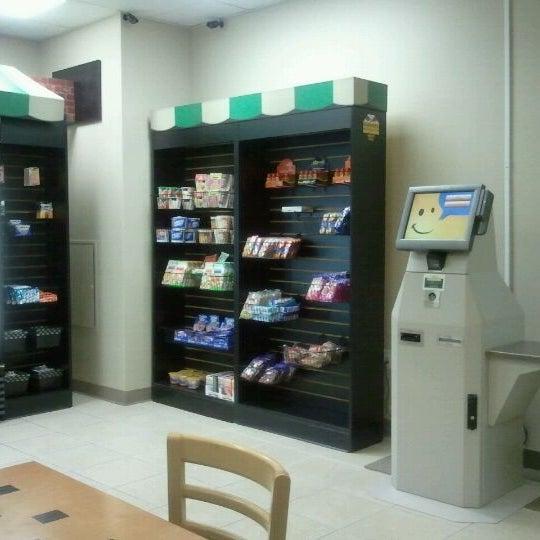 Photo taken at Village Market (Lobby Level) by Arnaldo R. on 4/11/2012