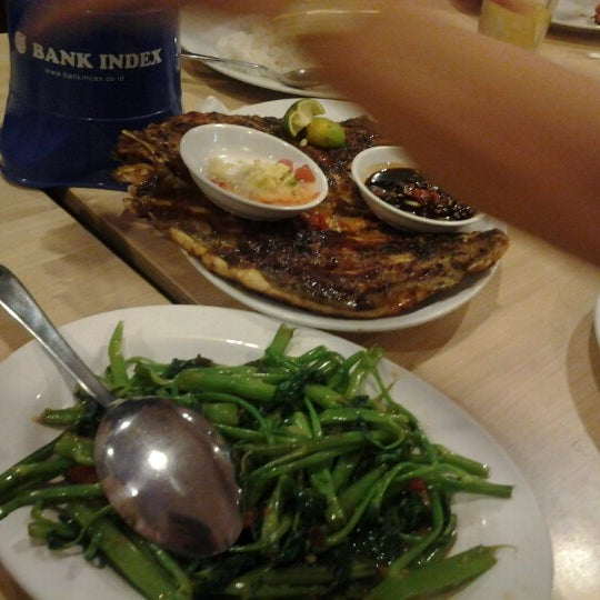 Photo taken at Rasane Seafood & Ikan Bakar by Allen S. on 7/15/2012