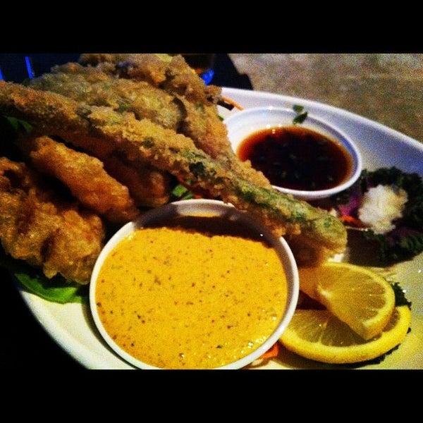 Photo taken at Blue Sushi Sake Grill by Mr. Gabe S. on 10/31/2011