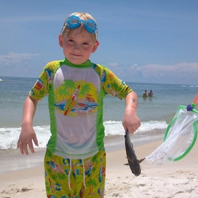 Graham catches first shark at six. BARE HANDED