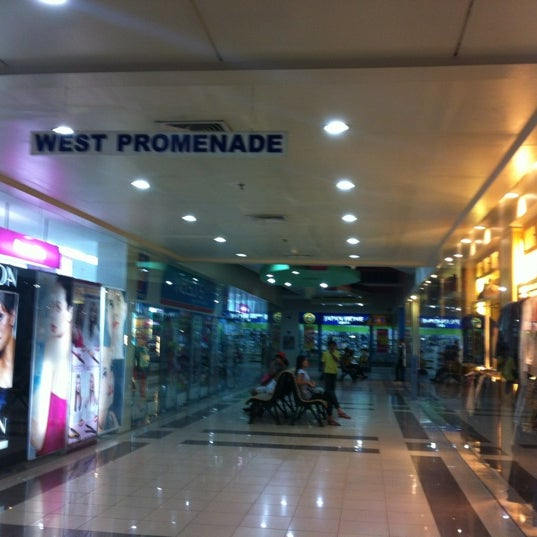 Photo taken at Limketkai Center by Cora G. on 2/12/2012