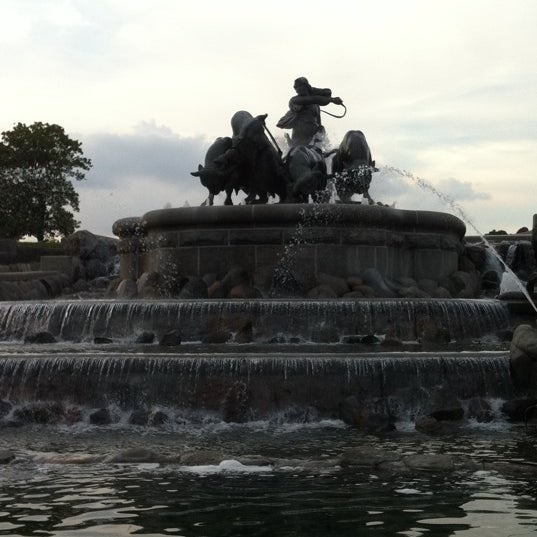 Photo taken at Gefionspringvandet (Gefion Fountain) by Ole N. on 7/10/2011