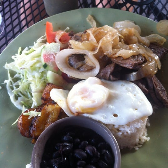 Photo taken at Irazu Costa Rican Restaurant & Catering by Wendy P. on 7/13/2012