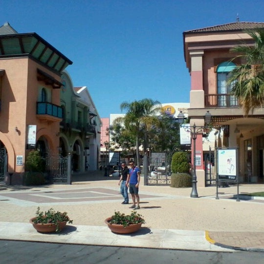 Photo taken at Fashion District - Molfetta Outlet by Linda A. on 6/23/2012