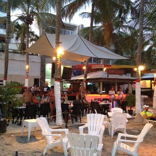 Photo taken at Playa El Yaque by Juan Andrés P. on 8/11/2012