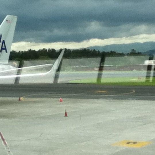 Photo taken at Gate 5 Aeropuerto Internacional Juan Santamaria by Martha T. on 7/20/2012