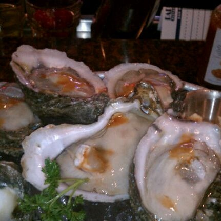 Photo taken at Pappadeaux Seafood Kitchen by Miatta M. on 3/30/2012