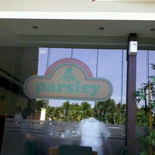 Photo taken at Parsley Bakery & Cake Shop by Adi Nugroho N. on 8/25/2012