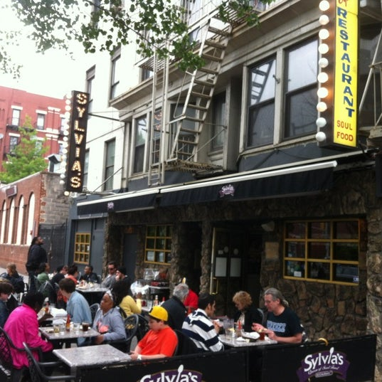 Photo taken at Sylvia's Restaurant by Scott S. on 5/5/2012