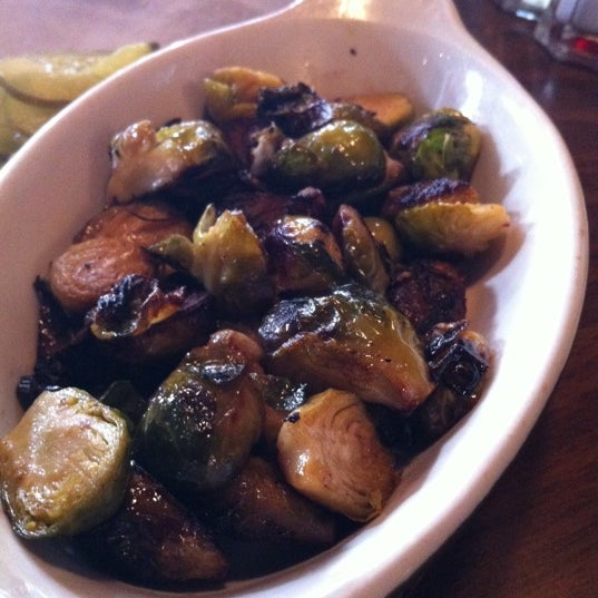Even if you don't love Brussels sprouts, eat this little guys. They're pan fried -- not boiled. Warning: will melt your face.
