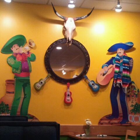 Photo taken at El Rodeo Mexican Bar & Grill by Sarah W. on 2/4/2012