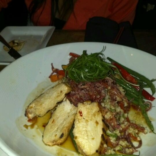 Photo taken at Blue Sushi Sake Grill by Brian D. on 2/26/2012