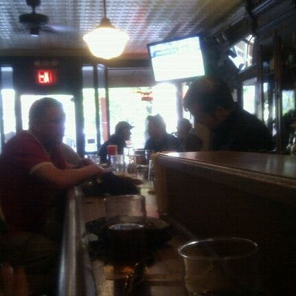 Photo taken at 11th Street Bar by Susie S. on 4/30/2011