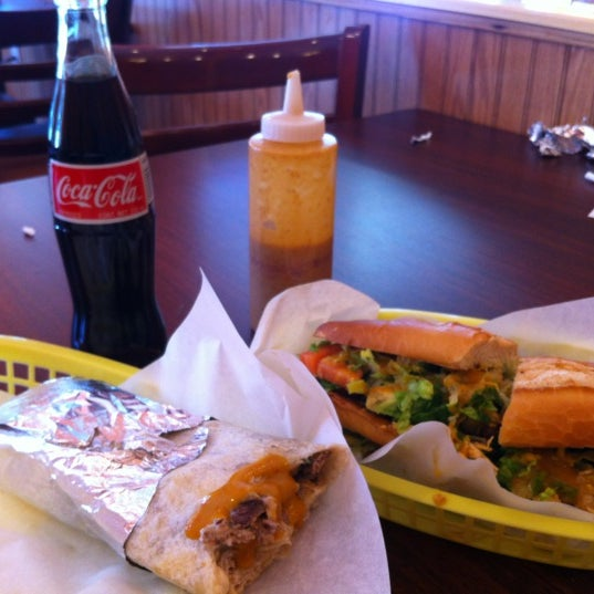 Photo taken at La Victoria Taqueria by Brian R. on 2/19/2012