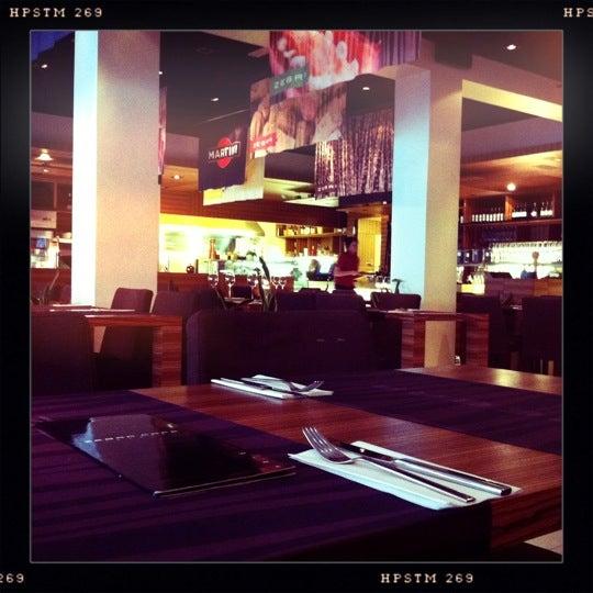 Photo taken at Zebra Café by Toni H. on 4/8/2011