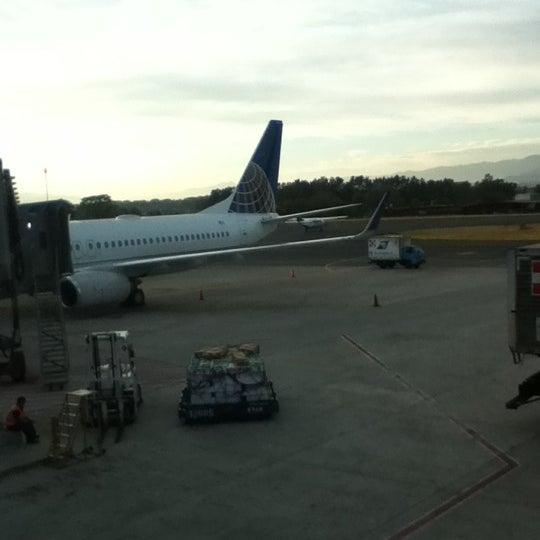 Photo taken at Gate 5 Aeropuerto Internacional Juan Santamaria by Mari Z. on 4/6/2012