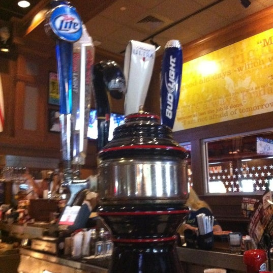 Photo taken at TGI Fridays by Lydia R. on 3/10/2012