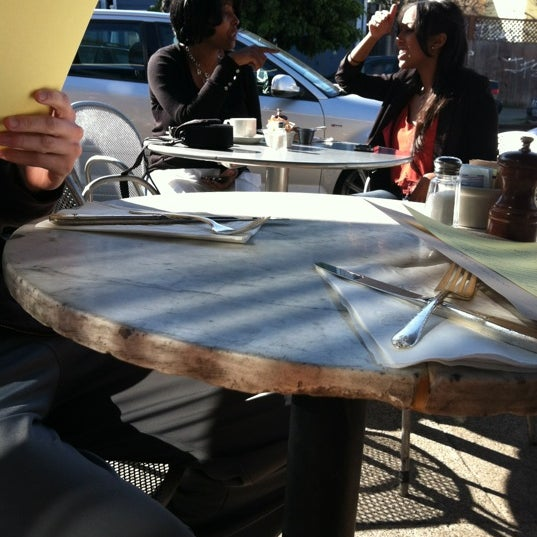Photo taken at Universal Cafe by Cherlyn M. on 3/4/2012